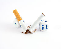 Cigarette with gambling dice Royalty Free Stock Photography