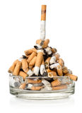 Cigarettes in a glass ashtray Stock Images