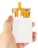 Cigarettes in hand Stock Photo