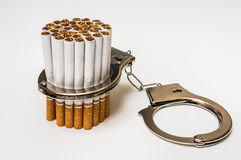 Cigarettes and handcuffs - smoking addiction concept Stock Image
