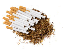 Cigarettes on a heap of loose tobacco, view from above Royalty Free Stock Photos