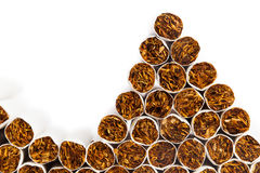 Cigarettes heap on the production line Royalty Free Stock Images