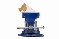 Cigarettes Held in Blue Vise Grip - End View. Pack of cigarettes held in a blue vise grip.  Isolated on white.  Concepts could include vice in a vise, dealing Royalty Free Stock Image