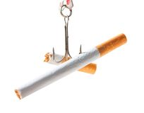 Cigarettes on the hook. Stop smoking Stock Images
