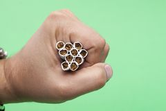 Cigarettes in the human hand Royalty Free Stock Photo