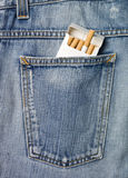 Cigarettes in a jeans pocket Royalty Free Stock Image