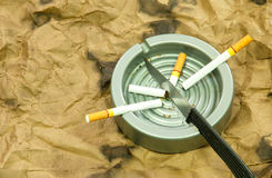 Cigarettes and knives Royalty Free Stock Image