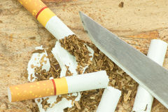 Cigarettes and knives Royalty Free Stock Photos