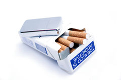 Cigarettes and lighter. Packet of cigarettes, with warning sign: Tobacco is addictive and zippo lighter Stock Photography