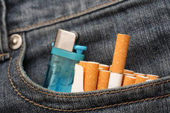 Cigarettes and lighter in pocket of jeans Stock Photo