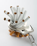 Cigarettes locked to handcuffs Royalty Free Stock Images