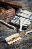 Cigarettes made from fresh tobacco and tablets Stock Photos