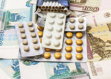 Cigarettes and medical drugs lie on banknotes Royalty Free Stock Image