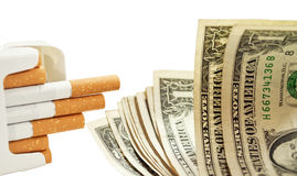 Cigarettes and money Royalty Free Stock Photo