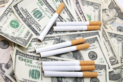 Cigarettes and money Royalty Free Stock Photos
