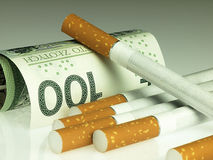 Cigarettes and money. Expensive habit. Royalty Free Stock Photo