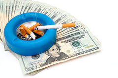 Cigarettes - Money Up In Smoke Royalty Free Stock Images