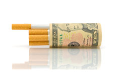 Cigarettes and money on a white background Stock Photography