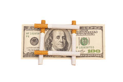 Cigarettes and money Stock Image