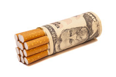 Cigarettes and money Royalty Free Stock Images