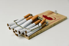 Cigarettes in a mousetrap stock image