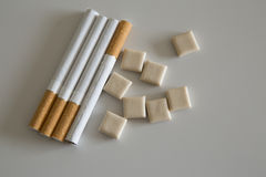 Cigarettes and nicotine gum Royalty Free Stock Photography