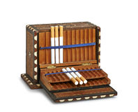 Cigarettes in old box (clipping path ) Stock Images