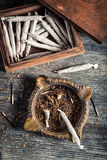 Cigarettes in old wooden box, ashtray and lighter Royalty Free Stock Image