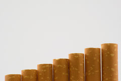 Cigarettes in one raw. Cigarettes in box on white background close-up Stock Photography