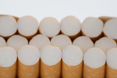 Cigarettes in one raw close up. Cigarettes  on white background close-up Stock Photo