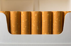 Cigarettes in pack stock images