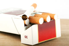 Cigarettes in pack on the breadboard Stock Images