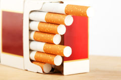 Cigarettes in pack on the breadboard Stock Photo