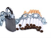 Cigarettes and a padlock Royalty Free Stock Photography