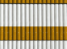 Cigarettes Pattern. A pattern of horizontally aligned cigarettes Royalty Free Stock Images