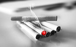 Cigarettes pile black and white Royalty Free Stock Photos