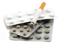 Cigarettes and pill Royalty Free Stock Photo