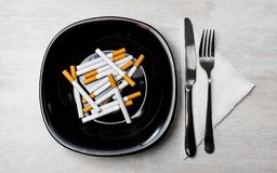Cigarettes meal with fork and knife royalty free stock photos