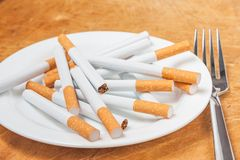 Cigarettes on a plate Stock Photo