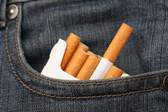 Cigarettes in pocket of jeans Royalty Free Stock Photo