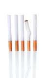 The Cigarettes in a Row with One Crumpled Royalty Free Stock Photo
