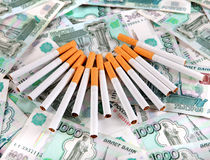 Cigarettes on the Russian Currency Royalty Free Stock Photo