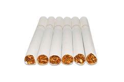 Cigarettes. Six cigarettes isolated on white background Stock Photography