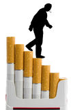 Cigarettes and smoker. Cigarettes like a staircase and silhouette of smoker, isolated on white Stock Image