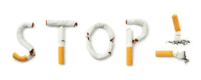 Cigarettes with stop smoking concept text Royalty Free Stock Photo