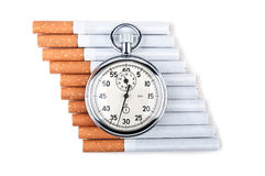 Cigarettes and stopwatch Stock Image