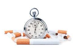 Cigarettes and stopwatch Stock Images
