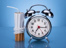 Cigarettes Tied With Rope And Alarm Clock Royalty Free Stock Photography