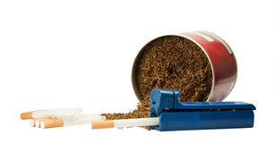 Cigarettes and tobacco. Device for packing cigarettes and tobacco liners Royalty Free Stock Photography