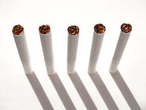 Cigarettes and tobacco products. Cigarettes and tobacco products paper nicotine filter habit Royalty Free Stock Images